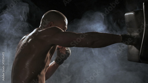 Tuinposter Gymnastiek Kickboxer shadow boxing as exercise for the big fight