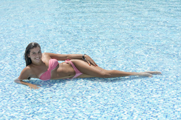 Beautiful woman enjoyin in swimming pool