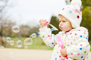 cute toddler with soap bubbles