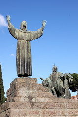 Statue of Saint Francis in St. John Lateran square of Rome