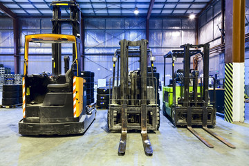 Forklifts in warehouse