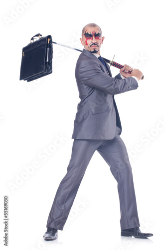 Businessman with sword isolated on white