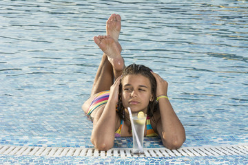 Beautiful woman enjoyin in swimming pool