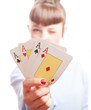 girl holding poker cards on a white background