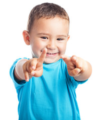 child doing the victory symbol on a white background