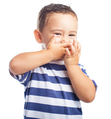 child covering his mouth on a white background