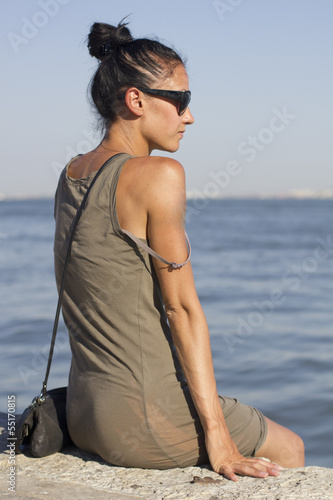 Young woman relaxing at the shore