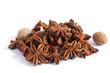 Anise pile and nutmeg on white background