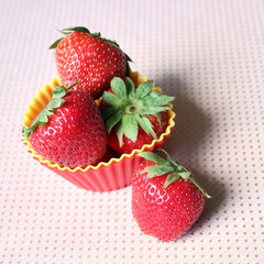 Strawberries in muffin cup, baking ingredients for cupcake