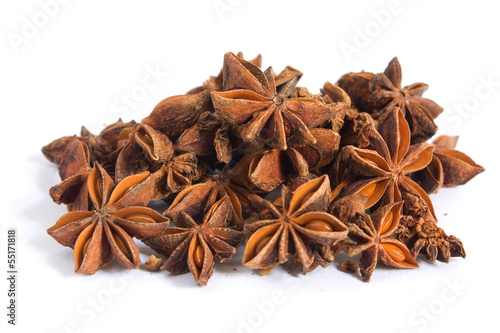 A pile of anise on white background