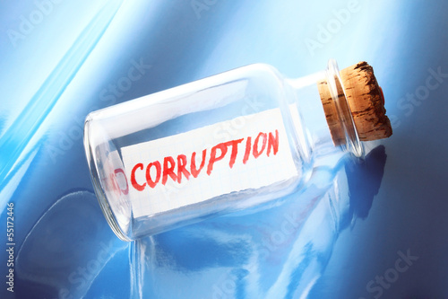 "concept of a bottle with a message ""Corruption"""