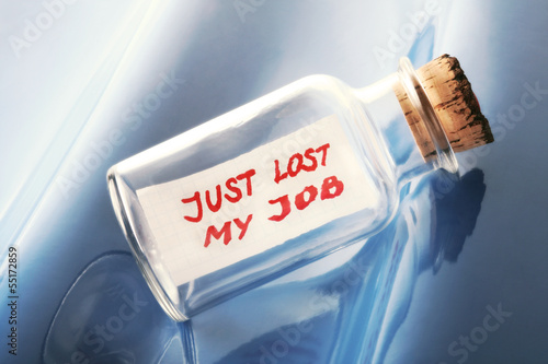 "concept of a bottle with a message ""Just lost my job"""