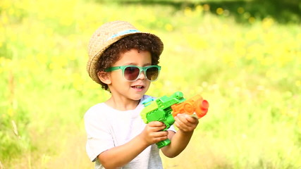African american boy having fun with water gun