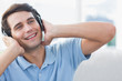 Cheerful man enjoying music