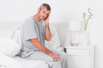 Anxious man holding his head