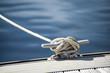 Leinwandbild Motiv Detail image of yacht rope cleat on sailboat deck