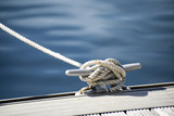 Fototapety Detail image of yacht rope cleat on sailboat deck