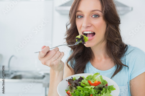 Brunette eating healthy salad