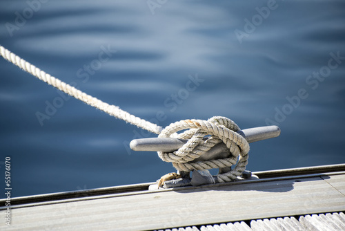 Detail image of yacht rope cleat on sailboat deck - 55176070