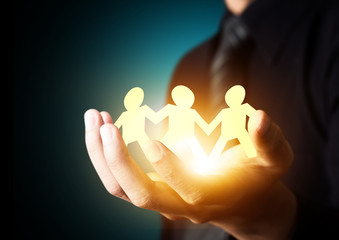 Paper family in hand, insurance concept