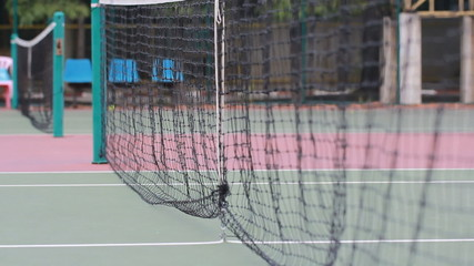 Tennis ball in net  on the game