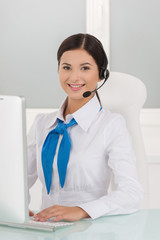 Young customer service representative. Cheerful young female cus