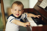 little funny boy plays piano