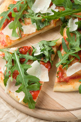 Pizza with arugula (rucola)