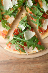 Pizza with arugula top view