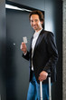 Businessman with key card for room door in hotel