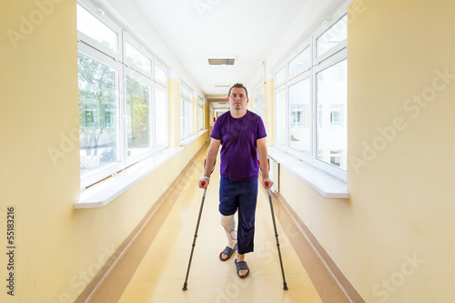 Man walks on crutches after arthroscopic surgery