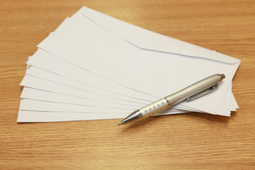 envelopes with a pen on atable