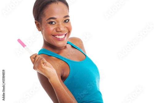 african woman holding pregnacy test