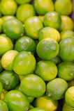 Lots of bright green limes in supermarket