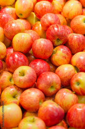 Lots of bright apples in supermarket