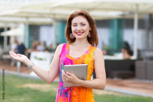 Young girl browsing trendy tablet pc