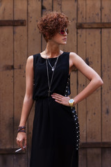 Cool hipster girl in dress with spikes