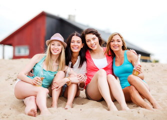 girls with drinks on the beach