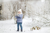 Little girl having fun on winter day