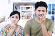 Afraid couple biting nails at home