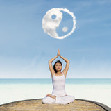 Yoga exercise under Yin Yang cloud