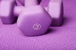 Three pound weight on a purple yoga mat