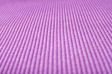 Close up shot of a purple yoga mat