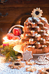 Christmas tree Pandoro with candle light