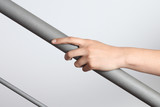 Woman hand using a railing to go upstairs