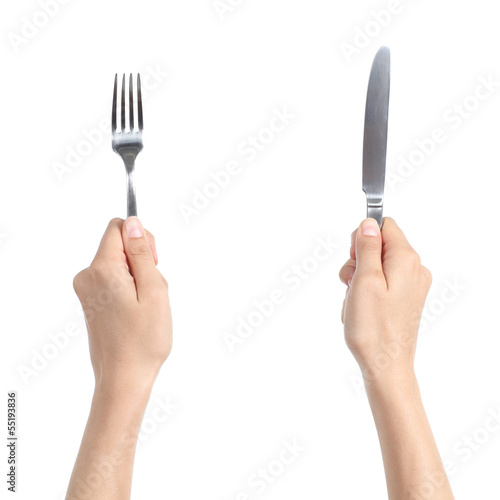 Woman hands holding a fork and a knife