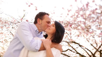 Happy mature couple in spring, kissing and hugging