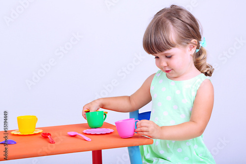Little cute girl sitting