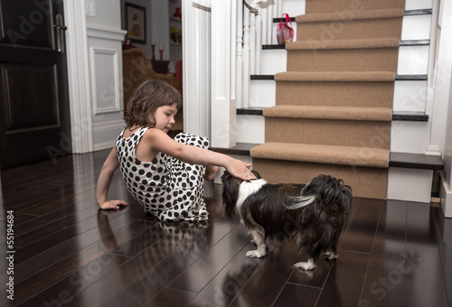 little girl playing with the dog