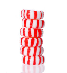 Peppermint candy tower isolated on white